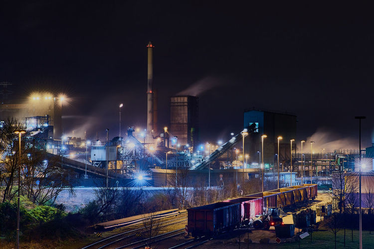 Steelplant in Duisburg, Germany, at night with a train in the front of the scene - very surreal Factory Heavy Industry Industrial Nature Nightphotography Pollen Production Ruhrgebiet Smoke Steel Cable Surrealist Art Capture Tomorrow