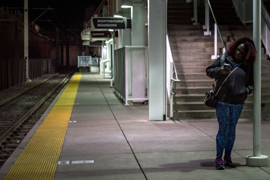 Night Photography Adult Architecture Full Length Lifestyles People Public Transportation Railroad Station Railroad Station Platform Real People Rear View Standing Transportation Using Mobile Phone