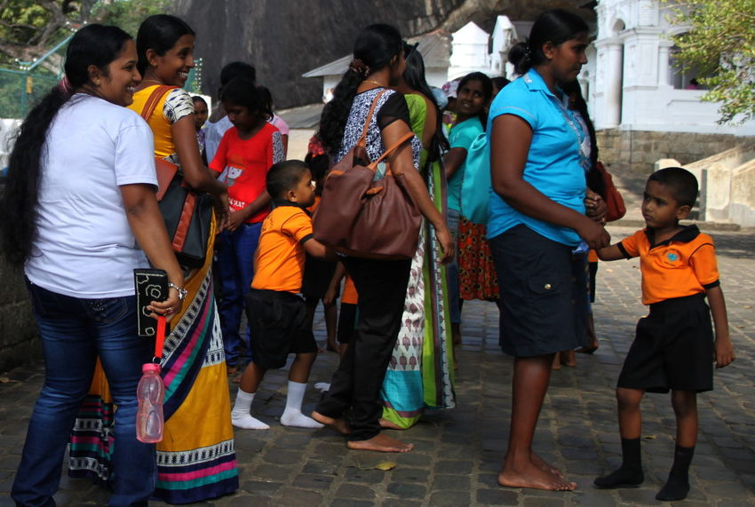Casual Clothing Dambulla Day Enjoyment Fun Lifestyles Medium Group Of People Mixed Age Range Outdoors Sri Lanka Togetherness Women And Children