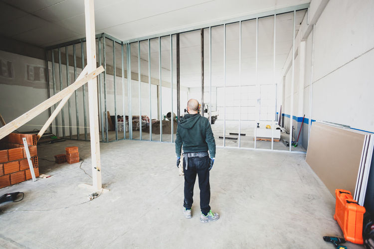Rear view of construction worker standing at site