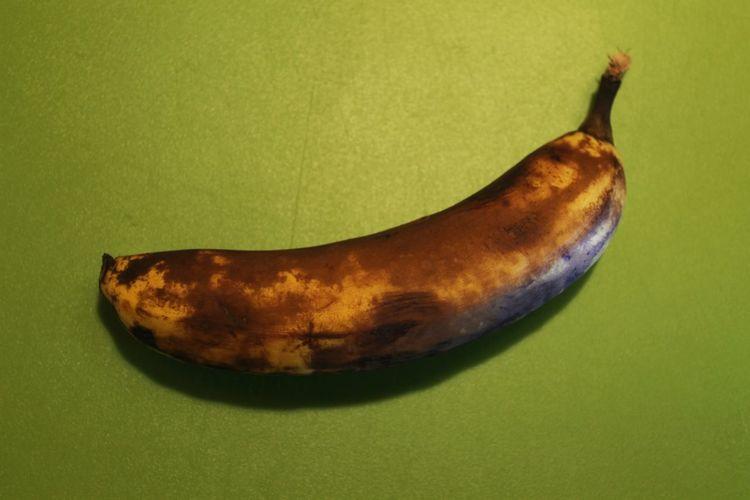 Sad banana Studio Shot Colored Background Fruit No People Food And Drink Healthy Eating Close-up Food Day Banana