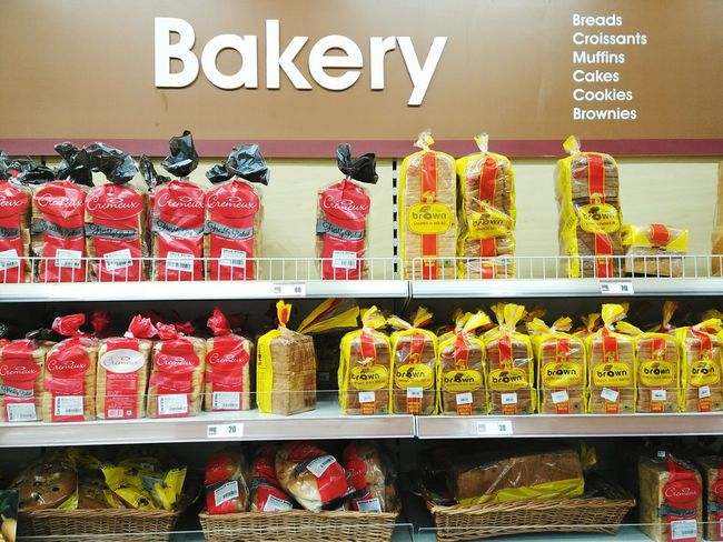 Variety of bakery products on shelves at Big Bazaar in Mall De Goa. Big Bazaar Bakery Bakery Products Baked Goods Supermarket Market Hypermarket Goa Cremeux Breads Croissants Muffins Cakes Cookies Brownies Products Display Grocery Shop Shelves Offer Consumerism Discounts Shopping Commerce