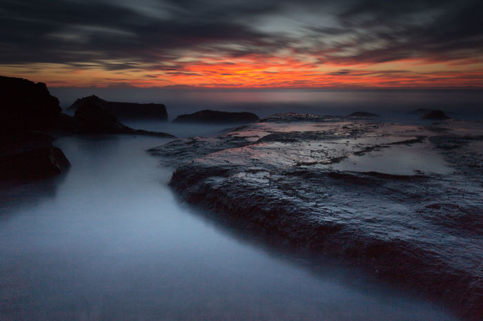 Beach Beauty In Nature Cloud - Sky Dramatic Sky Idyllic Landscape Long Exposure Misty Waters Motion Nature No People Outdoors Red Clouds Red Sunrise Rock - Object Scenics Sea Sky Sunset Tranquil Scene Tranquility Tree Area Water