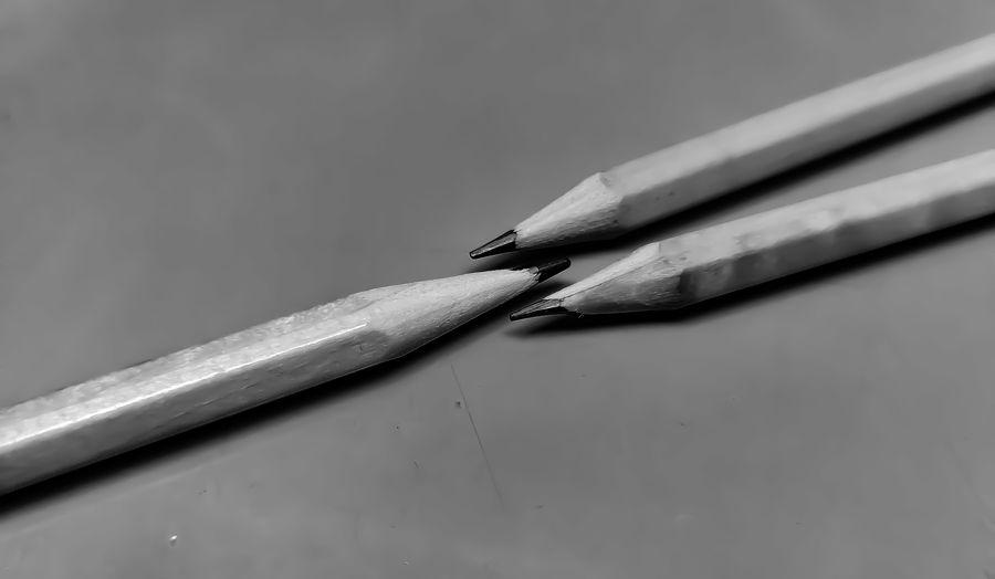 High angle view of pencils on metal