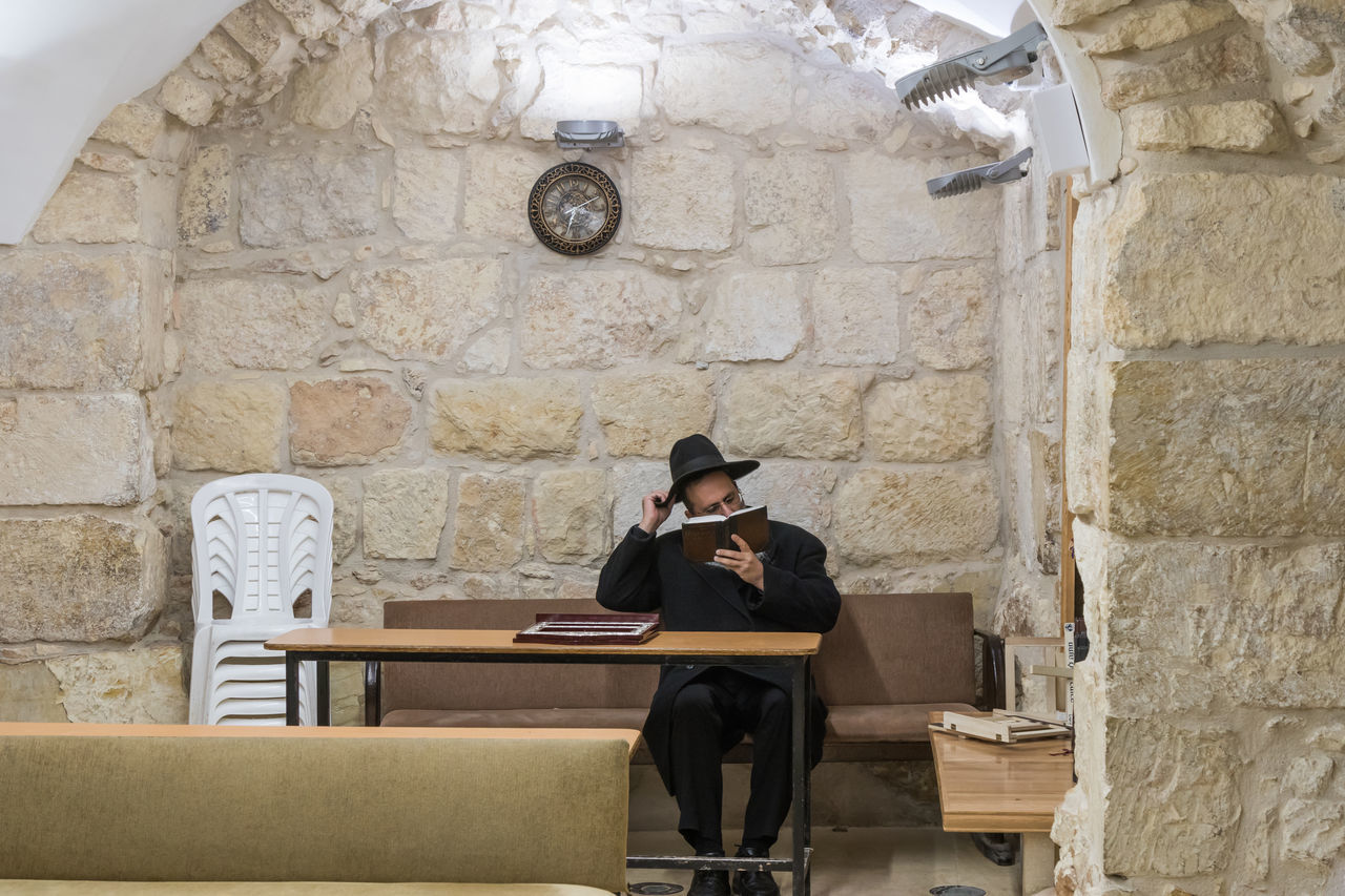 Jerusalem, Israel, November 25, 2017 : A religious Jew reads the Torah in the synagogue on the Grave of Samuel - The Prophet in Jerusalem in Israel An-Nabi Samwil Ancient Architecture Faith God Grave Of Samuel - The Prophet Jerusalem Governorate Jewish Palestine Tomb Worship Al-Nabi Samuil History Holy Islam Israel Minaret Mosque Muslim Old Prayer Prophet Religion Ruin Stone