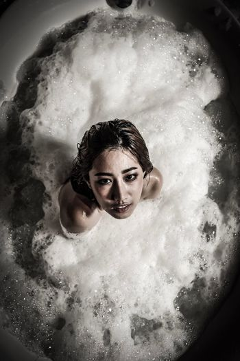 High Angle Portrait Of Young Woman In Bathtub