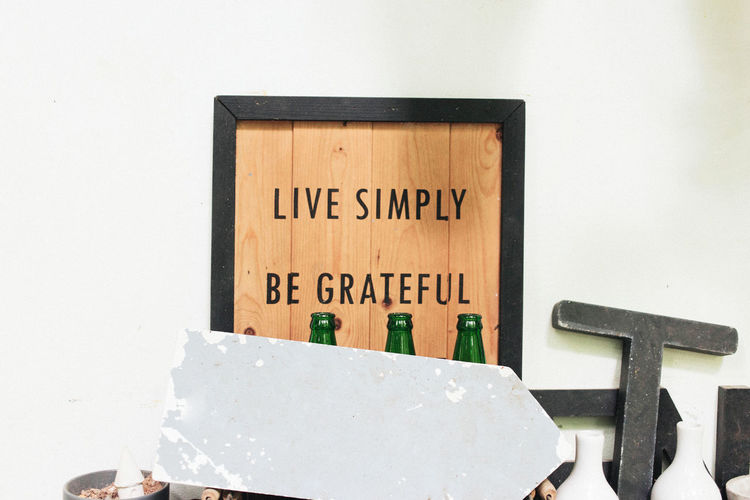 quotes on the wood frame with black border and grey plate four green bottle Backgrounds Border Bottle Copy Space Decoration Frame Green Background Interior Design Minimal Quotes Selective Focus Textured  Wood - Material