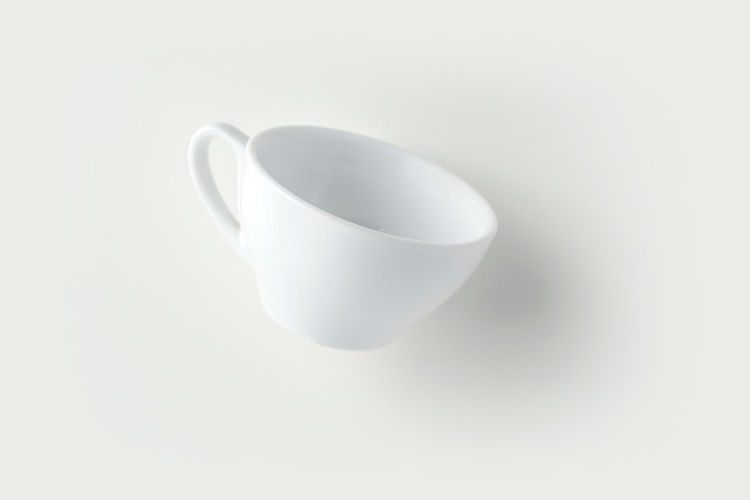 High angle view of empty coffee cup against white background