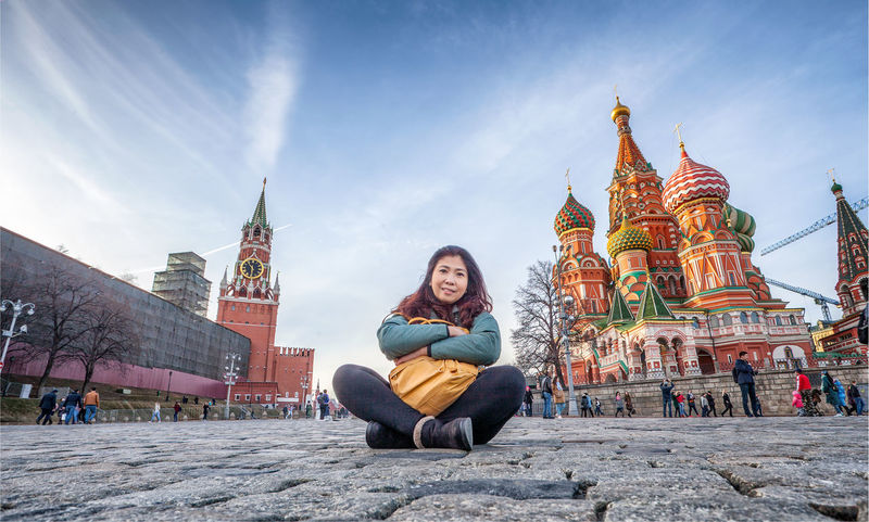 Moscow Red Square Russia Adult Architecture Built Structure Casual Clothing Lifestyles Looking At Camera Outdoors Place Of Worship Portrait Real People Religion Sitting Smiling Warm Clothing
