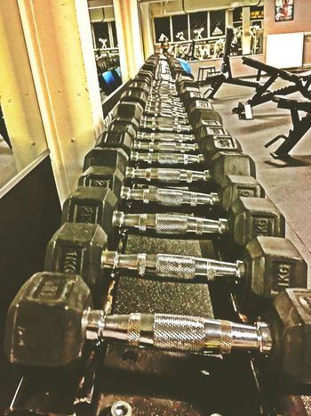 Beast mode ON 💪 Gym Gym Time Lifting Weights Dumbbell Weights Beast Train Hard Equipment Sports Selfie ✌ Strong Motivation EyeEmNewHere Healthy Lifestyle Stay Strong Stay Fit Indoors  In A Row No People Architecture Day Industry Factory