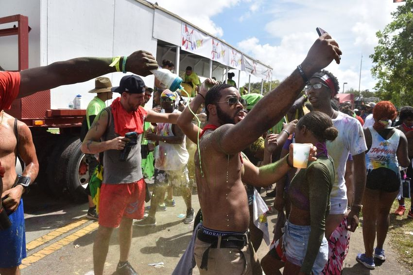 Jouvert Lauderhill Miami Carnival Jouvert Fun Large Group Of People Arms Raised Enjoyment Casual Clothing Outdoors Real People Holi Happiness Building Exterior Spraying Men Women Togetherness Standing Cheerful Leisure Activity Lifestyles Day Adult