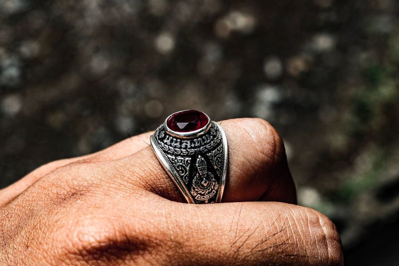 Close-up of person wearing ring