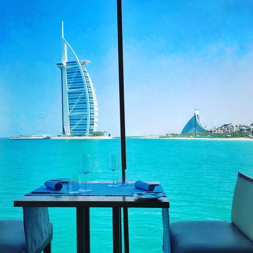 True blue....what a view! Dubai Luxiry Lifestyle Shot On IPhone Sea Water Blue Sky Sea Nature Transportation Day Table No People Travel Clear Sky Architecture Built Structure Outdoors