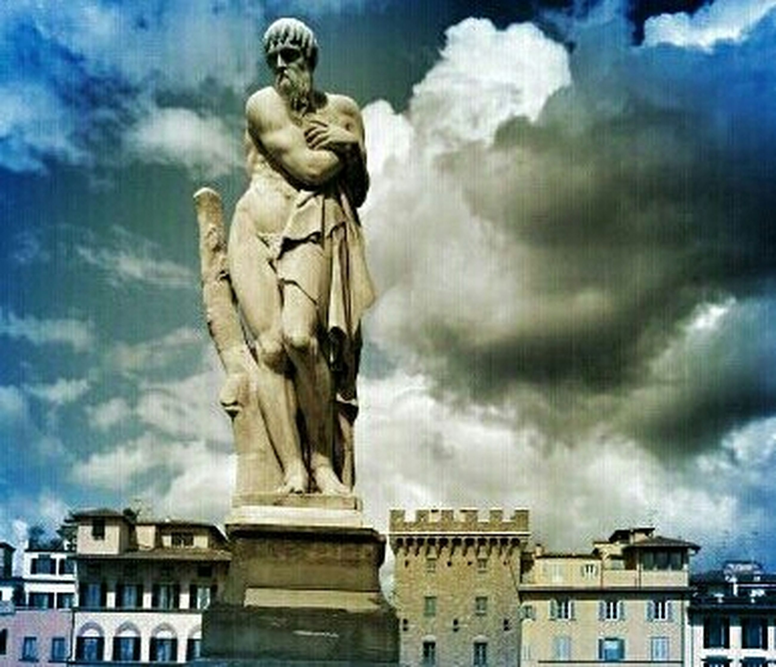 statue, human representation, sculpture, art and craft, art, creativity, sky, low angle view, cloud - sky, building exterior, built structure, architecture, cloudy, cloud, animal representation, carving - craft product, craft, history