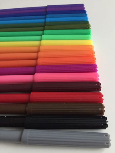 Close-up of colorful felt tip pens on table
