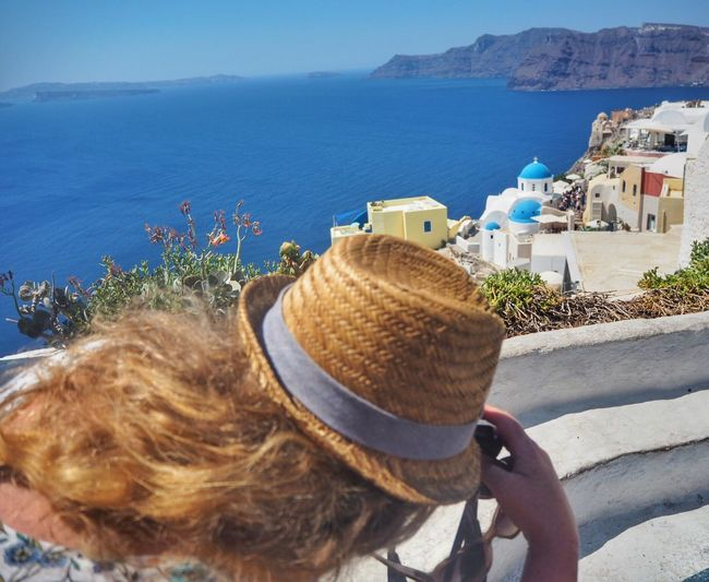 The women with the hat - looking for motives in Santorini Beauty Hobbyphotography Tourisme Tourist Oia Santorini Holiday Hat Water Sea Real People Day Architecture Built Structure Nature Sunlight Lifestyles Outdoors Building Exterior High Angle View Women Clothing Leisure Activity City Beach One Person