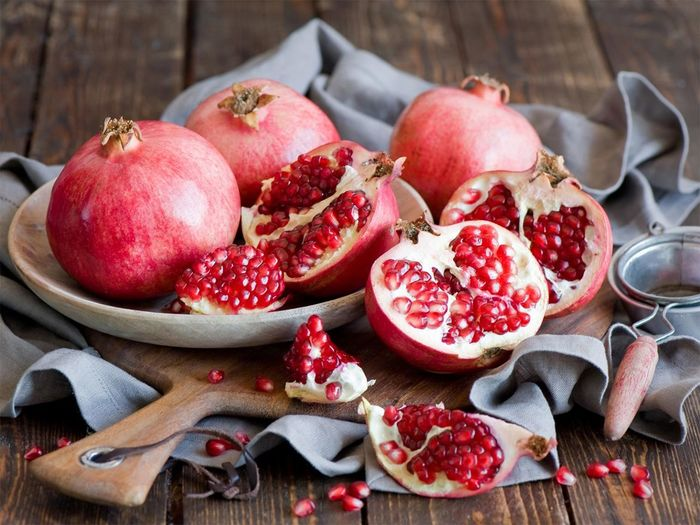 Close-up of pomegranates in plate on table