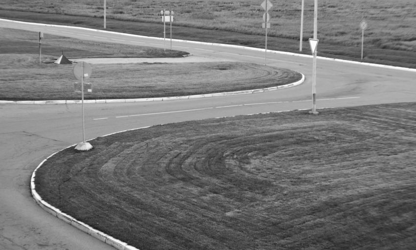 Ready for traffic Blackandwhite Field Landscape No People Outdoors Road Roadsign Sports Track Tranquility