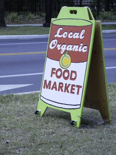 Street-side sign for a local, neighborhood organic food market. Communication Eco Farmer's Market Food Food Market Green Information Sign Local Market Natural Neighborhood Organic Organic Food Sign Signage Text Vegetables
