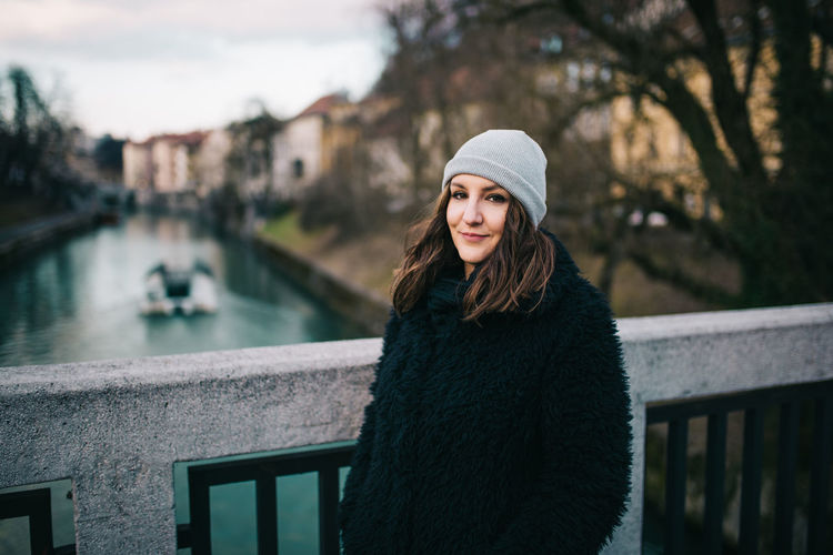 Warm Clothing Winter Young Adult Portrait One Person Clothing Beautiful Woman Hat Looking At Camera Standing Young Women Beauty Women Water Leisure Activity Lifestyles Real People Adult Focus On Foreground Hair Outdoors Hairstyle Canal Ljubljana International Women's Day 2019