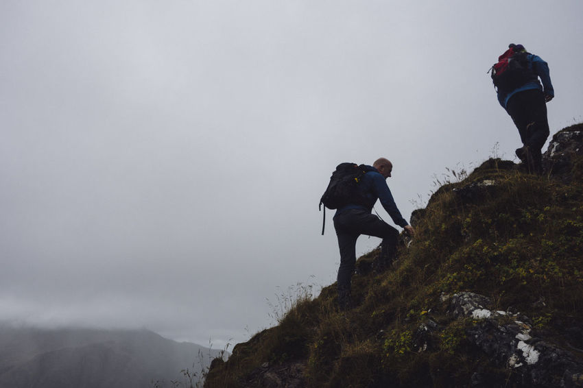 Dramatic Sky Glencoe Hiking Moody Sky Rain Raining Scotland Scrambling Adventure Challenge Climbing Cold Heavy Sky Hikers Men Moody Mountain Outdoors Overcast Scottish Highlands Survival Tough Toughness Wild Wilderness