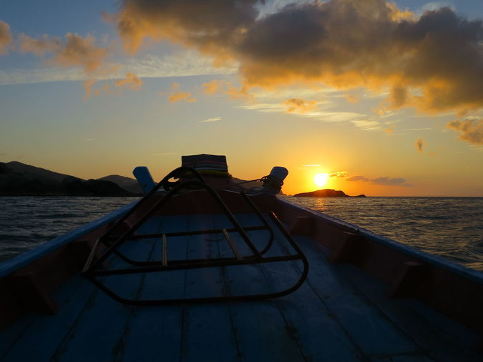 Longtail Boat Ride into the Sunset Beauty In Nature Boat Ride Bottle Beach Bug Cloud - Sky Clouds Clouds And Sky Longtail Longtail Boat Longtailboat Scenics Sky Sunset Travel