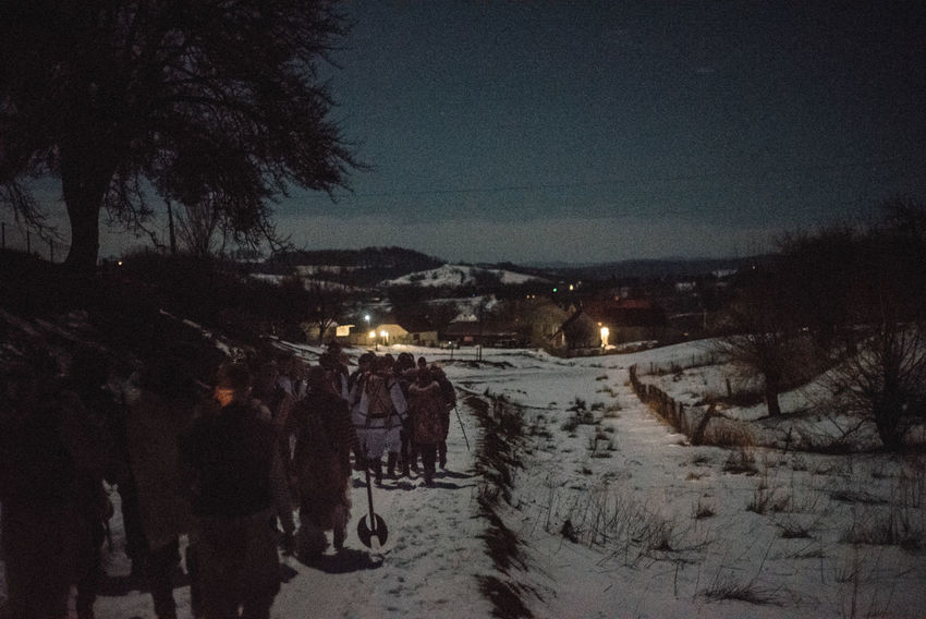 Carnival group walks from house to house during the Old New Year night. Crasna village, Ukraine. The Photojournalist - 2017 EyeEm Awards Shades Of Winter