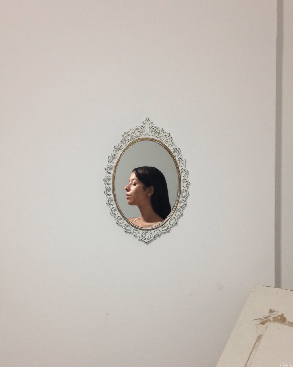 Reflection Of Woman On Mirror Mounted On Wall At Home