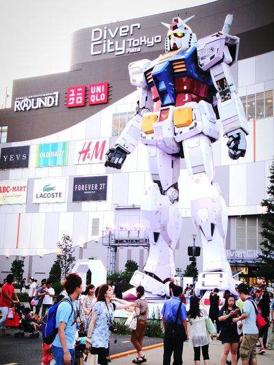 Gundam Large Group Of People Crowd Lifestyles People Built Structure Building Exterior Real People Day Outdoors Cityscape Adult City Sky Adults Only Gundamcollection Gundam Front Tokyo Gundam Build Fighter Gundam Model Gundam Tokyo,Japan Tokyo Japan The Week On EyeEm EyeEmNewHere