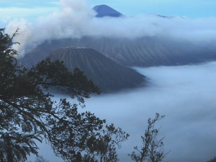 Scenic View Of Volcanoes In The Clouds