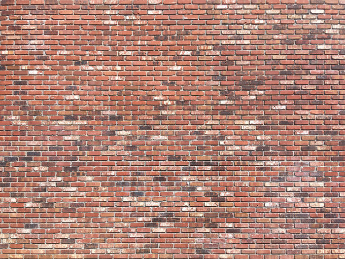 Full frame view of a large brick wall Brick Brick Wall Full Frame Wall Backgrounds Architecture Pattern Wall - Building Feature Built Structure Textured  No People Brown Repetition Day Red Construction Material Building Exterior In A Row Outdoors Close-up Copy Space