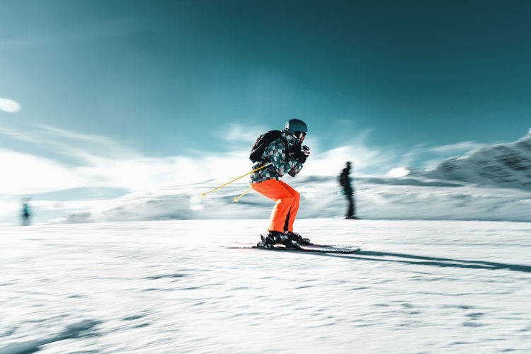 Snow Cold Temperature Winter Winter Sport Mountain Sport Skiing Leisure Activity Adventure Ski Pole Nature Day People Extreme Sports Vacations Mountain Range Full Length Motion Holiday Ski-wear Ski Holiday Warm Clothing Outdoors