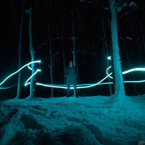 Illuminated Night Motion Long Exposure Tree Nature No People Cold Temperature Glowing Lighting Equipment Winter Light Painting Light Trail Light - Natural Phenomenon Snow Land Outdoors Water Light