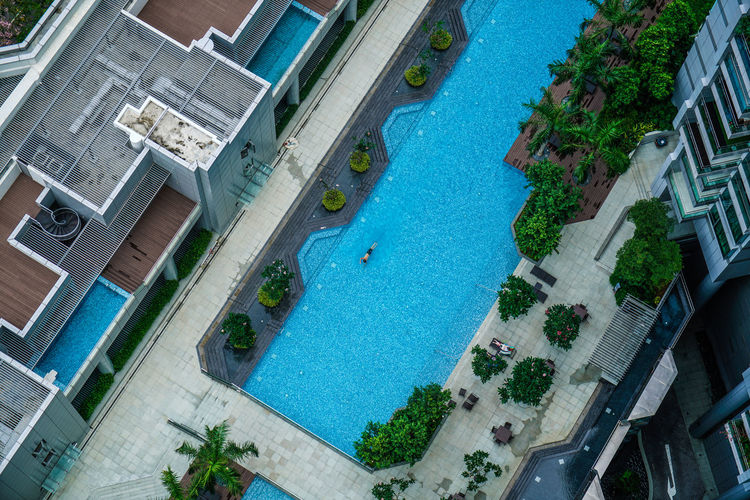 Directly Above Shot Of Swimming Pool Amidst Buildings In City