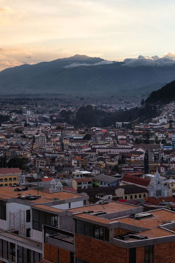 Atacazo mountain from Quito, Ecuador Architecture Building Exterior Built Structure City Crowded Sky Cityscape Building Residential District Crowd High Angle View Mountain Cloud - Sky Nature Community Town Sunset House TOWNSCAPE Outdoors Settlement Apartment Atacazo Andes Traveling