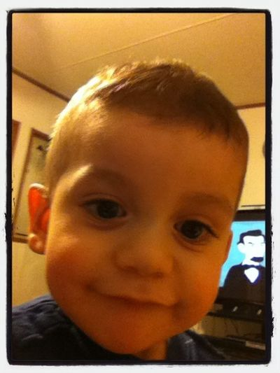 He's so adorable! <3 taking pictures with my iPod, smart kid.