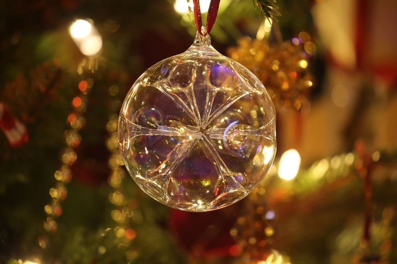 A bauble isn't only a ball of glass, it's a memory. I've bought a new bauble every year for over 30 years so my tree tells a tale or two... I call this one Sputnik. Decoration Christmas Celebration Illuminated Holiday Christmas Decoration Christmas Ornament christmas tree Christmas Lights Close-up Hanging Night Focus On Foreground No People Tree Indoors  Holiday - Event Lighting Equipment Light