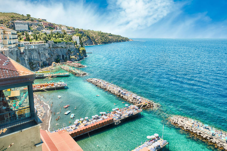 Scenic aerial view of Sorrento, Neapolitan Riviera, Italy, during summertime Architecture Beauty In Nature Building Exterior Built Structure Day Horizon Over Water Nature Nautical Vessel No People Outdoors Scenics Sea Sky Water