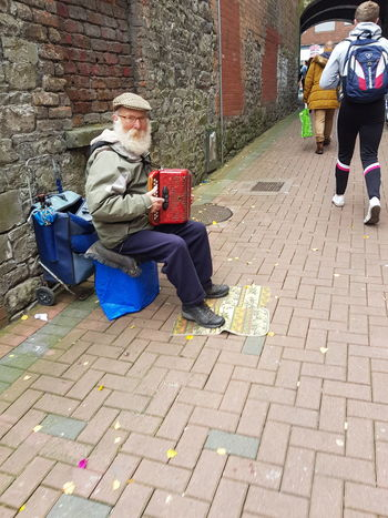 Busking in Limerick City Full Length Real People Adults Only People One Man Only Sitting Outdoors One Person Adult Only Men Architecture Instruments Traditional Culture Limerick City Ireland🍀 Busking Street Busking Artist