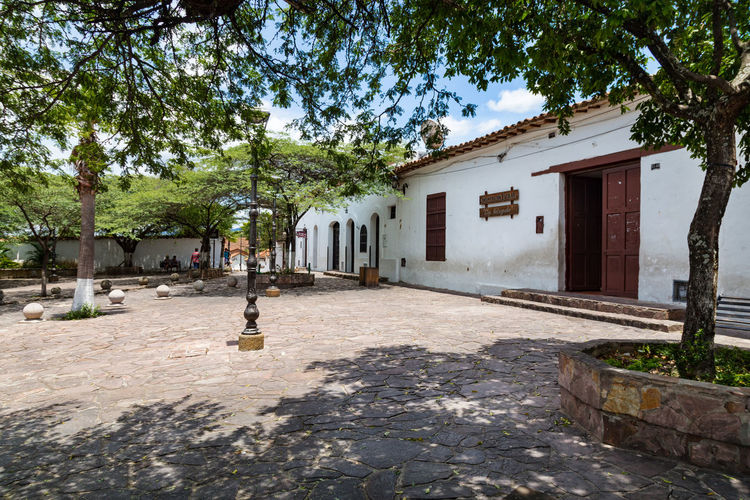 Peralta Plaza in Giron, Colombia. Colombia Exterior Latin America Santander Shade Sunny Travel Trees Architecture Bucaramanga Building Exterior Cobblestone Colombian  Colonial Day Destination Girón Historic No People Outdoors Park Peralta South America Tourism Tree