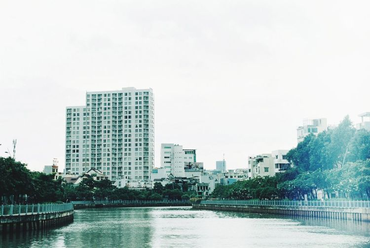 City Architecture Skyscraper Modern Building Exterior Downtown District Water Development Cityscape Urban Skyline Built Structure Business Finance And Industry City Life Sky Day No People Sea Office Outdoors Hochiminhcity Film Film35mm Analogue Photography Nikkormat City