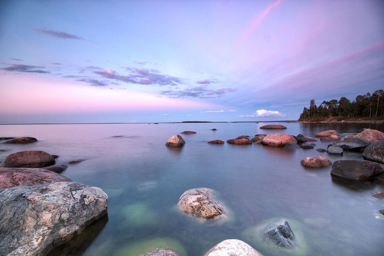Beauty In Nature Blue Calm Cloud Cloud - Sky Cloudy Coastline Idyllic Nature No People Non-urban Scene Outdoors Reflection Remote Rippled Rock Rock - Object Rock Formation Scenics Shore Sky Sunset Tranquil Scene Tranquility Water