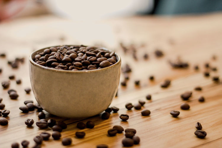 Food And Drink Food Wood - Material Roasted Coffee Bean Large Group Of Objects Close-up Freshness Coffee - Drink Brown Indoors  No People Seed Coffee Table Wellbeing Raw Food Focus On Foreground Selective Focus Bean Still Life Caffeine Wooden Spoon