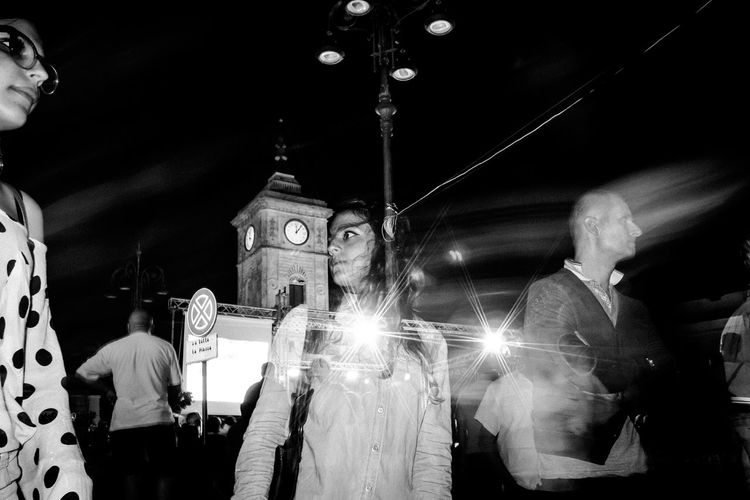 People at illuminated temple