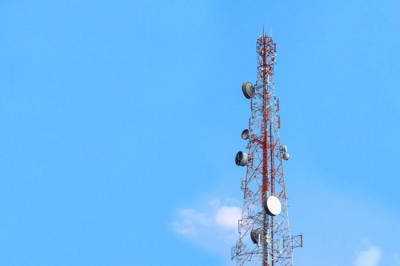 Telecommunication, Cellular or Radio antenna tower in blue sky background for Industrial energy power, network technology, digital data transport and communication concept idea design. EyeEm Best Shots EyeEm Selects EyeEmNewHere Transmission Antenna Antenna - Aerial Blue Broadcasting Cellular Clear Sky Clouds Communication Connection Copy Space Global Communications Low Angle View Metal Satellite Dish Sky Smart Phone Technology Telecommunications Equipment Telephone Television Industry Wireless Technology