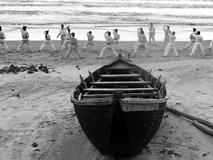 Different Life on Beach Beach Beach Life Beachphotography Black And White Boat Enjoyment Karate Leisure Activity Lifestyles Men Nautical Vessel Outdoors Real People Relaxation Sand Sea Shore Summer Togetherness Vacations Water Weekend Activities