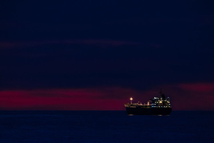 Sea Water Nautical Vessel Sky Nature Transportation Ship Oil Industry Offshore Platform No People Mode Of Transportation Industry Fuel And Power Generation Beauty In Nature Night Drilling Rig Fossil Fuel Illuminated Scenics - Nature Horizon Over Water Outdoors