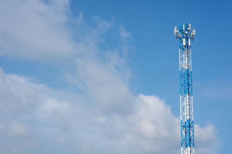 Wireless communication antenna transmitter. telecommunication towers with blue sky.