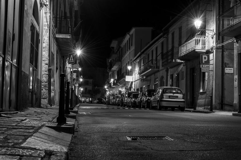 """The """"Mainstreet"""" of the small village """"Ceriana"""" in Liguria/Italy at night. So a nice village with friendly people. Night Illuminated Street Architecture Built Structure Outdoors Building Exterior City No People ARTsbyXD EyeEm Best Shots Low Angle View Streetphotography Street Photography Streetphoto_bw Streetphotography_bw Streetphotographer Street Light Village Italy Italy🇮🇹 Ceriana Sanremo Liguria Liguria,Italy EyeEm Selects"""