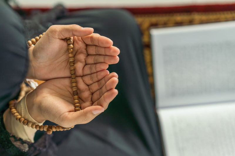 Midsection of woman praying